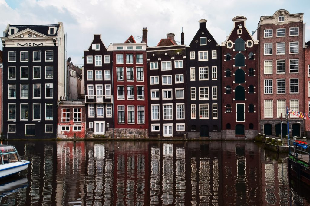 Amsterdam - The view is, apart from the beautiful, narrow buildings, especially beautiful because the buildings are located directly at the water.